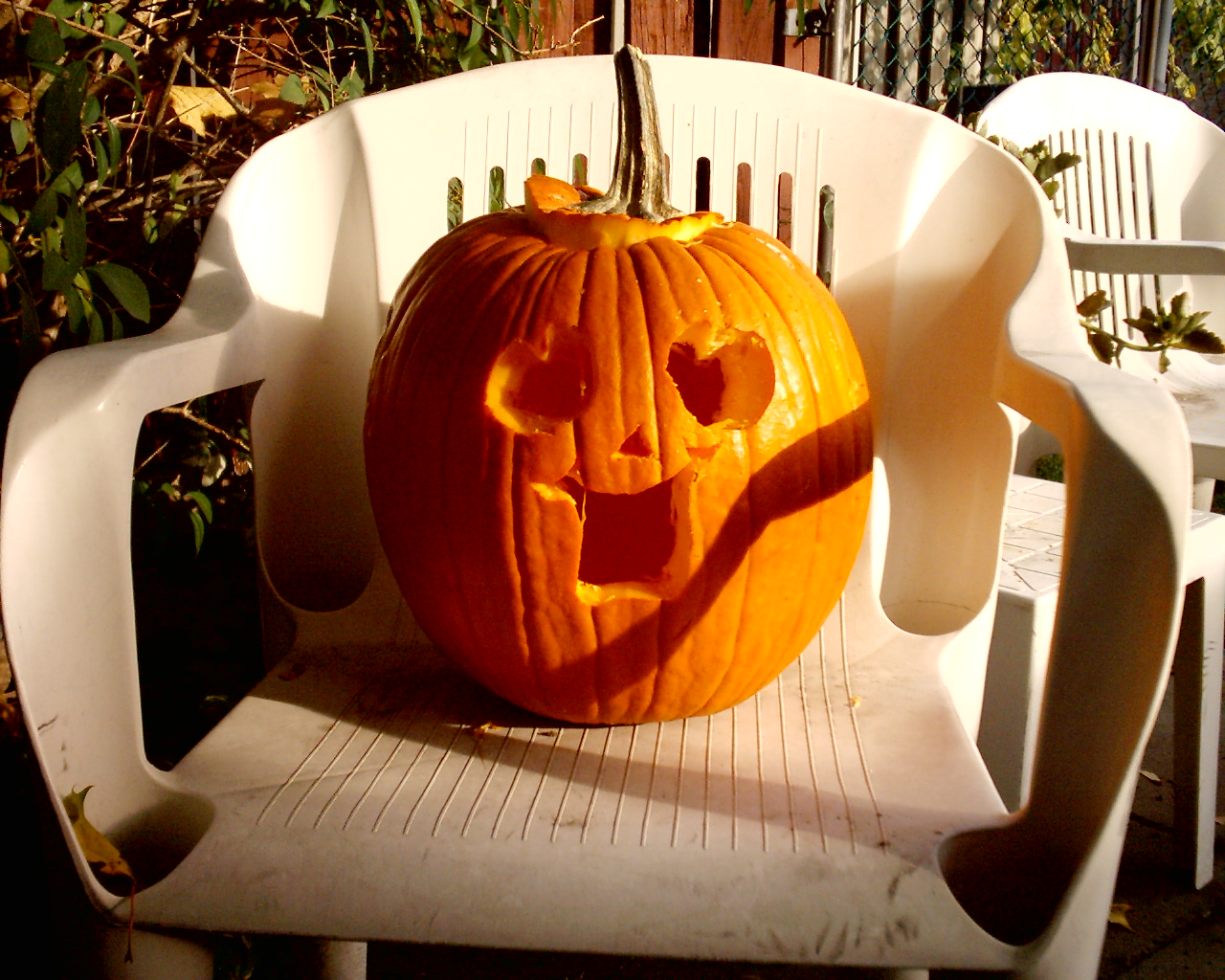 jack o' lantern on a chair